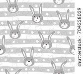 Stock vector seamless pattern with cute little bunny vector illustration 704228029