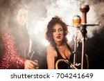 attractive women standing near... | Shutterstock . vector #704241649