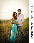 young and loving couple... | Shutterstock . vector #704244847