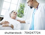 doctor talking to patient in... | Shutterstock . vector #704247724