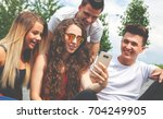 group of friends sitting... | Shutterstock . vector #704249905