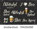 oktoberfest lettering set.... | Shutterstock .eps vector #704256385