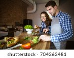 young man and woman cooking...   Shutterstock . vector #704262481