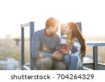 young man and woman embrace and ... | Shutterstock . vector #704264329