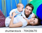 Happy Parents With Baby At Home.