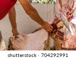 muslim butcher man cutting a...   Shutterstock . vector #704292991