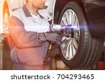 midsection of male mechanic...   Shutterstock . vector #704293465