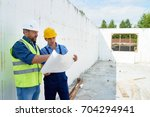 portrait of two construction... | Shutterstock . vector #704294941