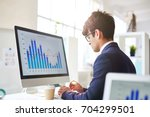 concentrated young white collar ...   Shutterstock . vector #704299501