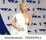 katy perry at the 2017 mtv... | Shutterstock . vector #704303911