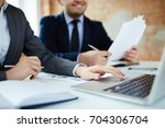 two economists or analysts... | Shutterstock . vector #704306704