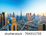 futuristic dubai city center ... | Shutterstock . vector #704311735
