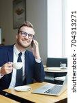 young salesman speaking on... | Shutterstock . vector #704313271