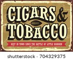 cigars and tobacco vintage sign ... | Shutterstock .eps vector #704329375