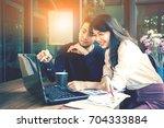 asian start up  freelance team... | Shutterstock . vector #704333884