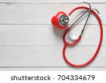 closeup red heart check with... | Shutterstock . vector #704334679