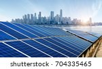 skyscrapers and solar panels ... | Shutterstock . vector #704335465