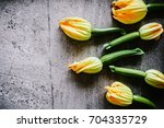 freshly harvested zucchini with ... | Shutterstock . vector #704335729