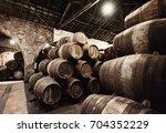 old wooden barrels in wine... | Shutterstock . vector #704352229