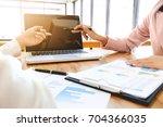 executive analysis on data... | Shutterstock . vector #704366035