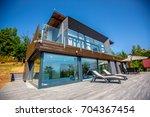 luxurious villa exterior | Shutterstock . vector #704367454
