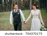 happy and smiled wedding couple ... | Shutterstock . vector #704370175