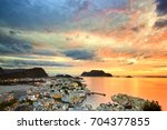cityscape of alesund at sunset  ... | Shutterstock . vector #704377855