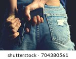 handheld gun hidden behind in... | Shutterstock . vector #704380561
