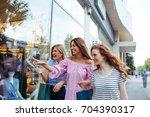 shot of three women window...   Shutterstock . vector #704390317