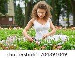 gorgeous young woman enjoying... | Shutterstock . vector #704391049