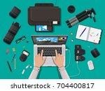 workspace of photographer.... | Shutterstock .eps vector #704400817