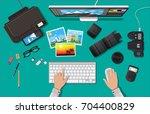 workspace of photographer.... | Shutterstock .eps vector #704400829