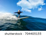 muscular surfer with long white ... | Shutterstock . vector #704405155