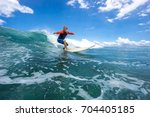 muscular surfer with long white ... | Shutterstock . vector #704405185