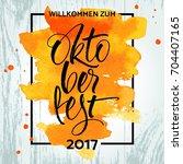 willkommen zum oktoberfest ... | Shutterstock .eps vector #704407165