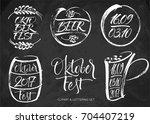 oktoberfest lettering and... | Shutterstock .eps vector #704407219