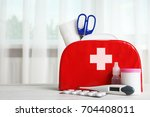 first aid kit and medicines on... | Shutterstock . vector #704408011