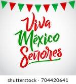 viva mexico senores   viva... | Shutterstock .eps vector #704420641