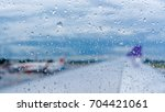 raindrops on airplane window at ...   Shutterstock . vector #704421061