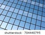 blue windows of a modern office ...   Shutterstock . vector #704440795