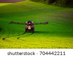 farm machinery spraying... | Shutterstock . vector #704442211