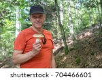 hiker with mushroom  black... | Shutterstock . vector #704466601