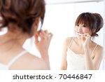 Beautiful Asian Woman Brushing...