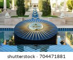 Small photo of UDAIPUR, INDIA - JANUARY 21, 2017: Sundial at the Oberoi Udaivilas Hotel. Located on the bank of Lake Pichola the hotel has over fifty acres, which includes a twenty-acre wildlife sanctuary.