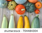 pumpkins and squashes on wooden ... | Shutterstock . vector #704484304
