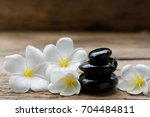 pile of black zen stones and... | Shutterstock . vector #704484811