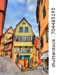 typical houses in the old town... | Shutterstock . vector #704485195