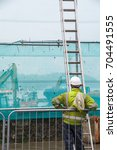 Small photo of Bantry,Ireland - December 05, 2016: Workman on building sire with ladder