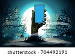 halloween background. hand with ... | Shutterstock .eps vector #704492191