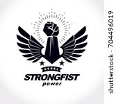 strong fist of a muscular man... | Shutterstock .eps vector #704496019